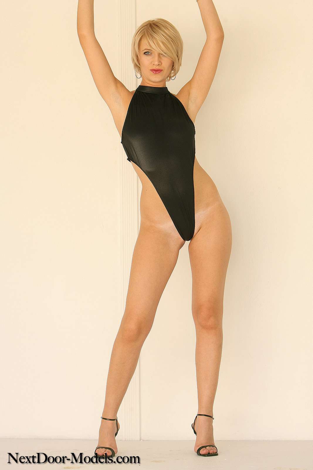High Cut Thong Leotard Porn - Maleena loves her high cut, shiny black one piece...did we mention it\\'s  also a thong?