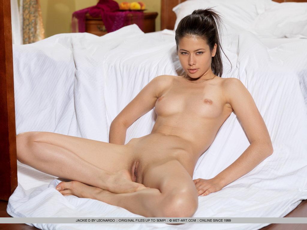 Jackie looks ravishing in sheer black thigh high stockings with her